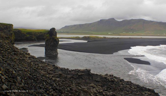 View of the black sand beach looking east.