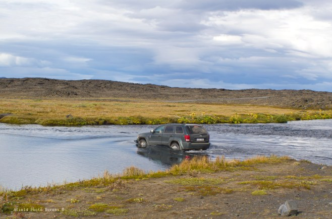 One of the few vehicle we met along the way - we had just crossed the river and noticed a little water coming in the doors.
