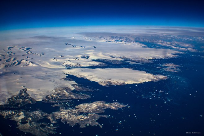 Greenland is not Green but it is amazing to look at. All those little white bits in the water are huge icebergs - 2013.